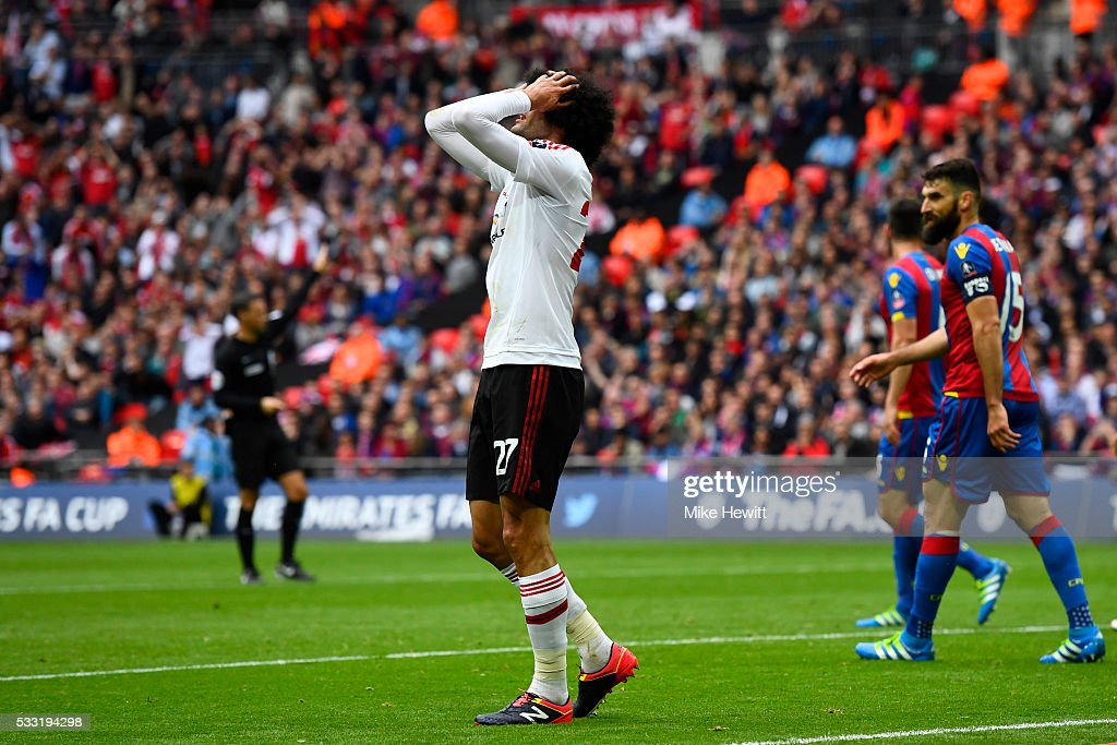 Marouane Fellaini of Manchester United reacts after a missed chance during The Emirates FA Cup Final match between Manchester United and Crystal Palace at Wembley Stadium on May 21, 2016 in London, England.