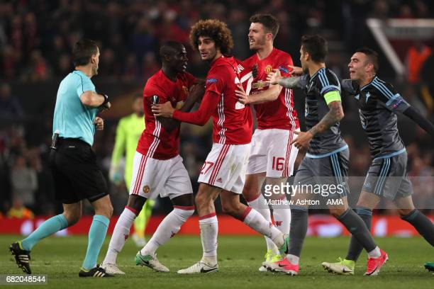 Marouane Fellaini of Manchester United reacts during the UEFA Europa League semi final second leg match between Manchester United and Celta Vigo at...
