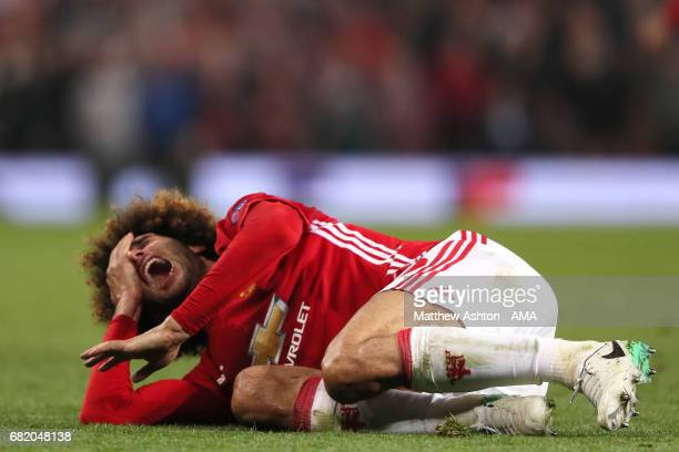 Marouane Fellaini of Manchester United reacts to a challenge during the UEFA Europa League semi final second leg match between Manchester United and...