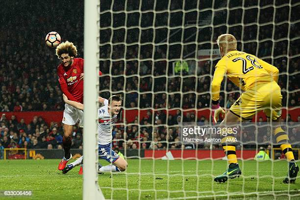 Marouane Fellaini of Manchester United scores the first goal to make the score 10 during the FA Cup fourth round match between Manchester United and...
