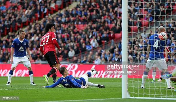 Marouane Fellaini of Manchester United scores the opening goal during the Emirates FA Cup Semi Final match between Everton and Manchester United at...