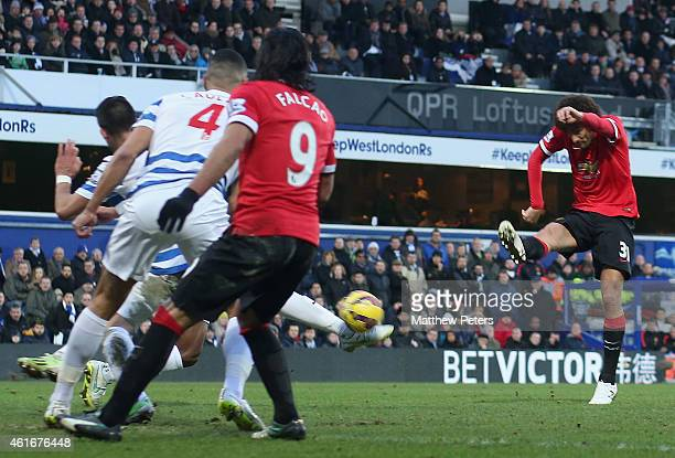 Marouane Fellaini of Manchester United scores their first goal during the Barclays Premier League match between Queens Park Rangers and Manchester...