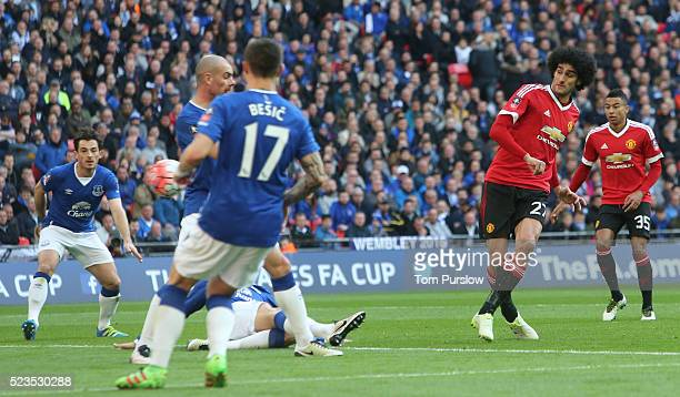 Marouane Fellaini of Manchester United scores their first goal during the Emirates FA Cup Semi Final match between Manchester United and Everton at...
