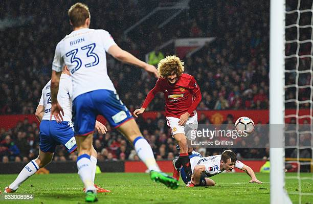 Marouane Fellaini of Manchester United scores their first goal during the Emirates FA Cup Fourth round match between Manchester United and Wigan...