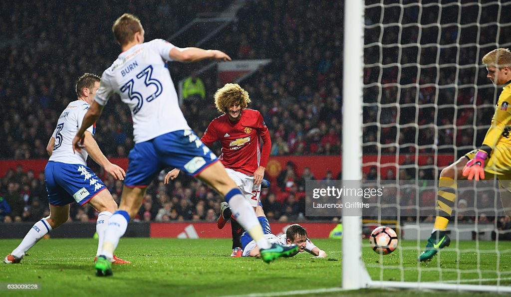 Marouane Fellaini of Manchester United (C) scores their first goal during the Emirates FA Cup Fourth round match between Manchester United and Wigan Athletic at Old Trafford on January 29, 2017 in Manchester, England.
