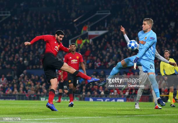 Marouane Fellaini of Manchester United shoots past David von Ballmoos of BSC Young Boys but misses the goal during the Group H match of the UEFA...