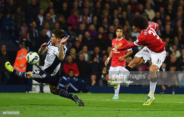Marouane Fellaini of Manchester United shoots past Sebastien Pocognoli of West Bromwich Albion to score their first and equalising goal during the...