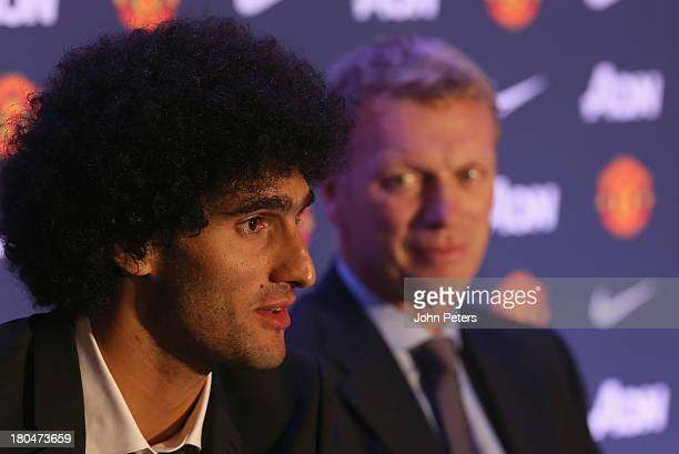Marouane Fellaini of Manchester United speaks during a press conference to announce his signing at Old Trafford on September 13, 2013 in Manchester,...