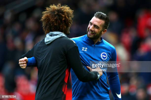 Marouane Fellaini of Manchester United speaks to Shane Duffy of Brighton and Hove Albion prior to the Premier League match between Manchester United...