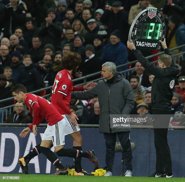 Marouane Fellaini of Manchester United speaks with Manager Jose Mourinho after being substituted during the Premier League match between Tottenham...