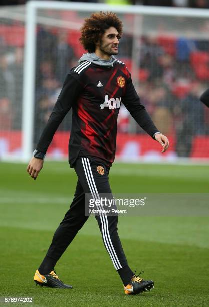 Marouane Fellaini of Manchester United warms up ahead of the Premier League match between Manchester United and Brighton and Hove Albion at Old...