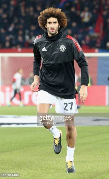 Marouane Fellaini of Manchester United warms up ahead of the UEFA Champions League group A match between FC Basel and Manchester United at St...