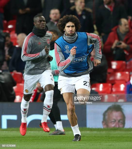 Marouane Fellaini of Manchester United warms up ahead of the UEFA Champions League Round of 16 Second Leg match between Manchester United and Sevilla...