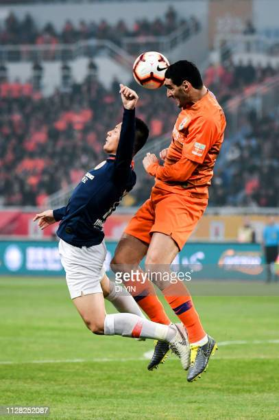 Marouane Fellaini of Shandong Luneng competes for a header during the 2019 Chinese Super League match between Shandong Luneng and Beijing Renhe at...