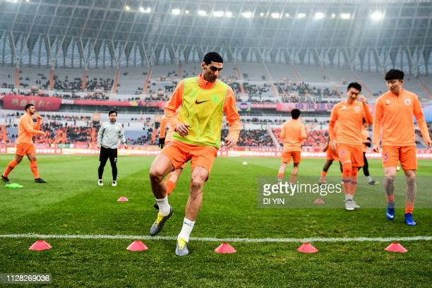 Marouane Fellaini of Shandong Luneng ctraining before the 2019 Chinese Super League match between Shandong Luneng and Beijing Renhe at Luneng Stadium...