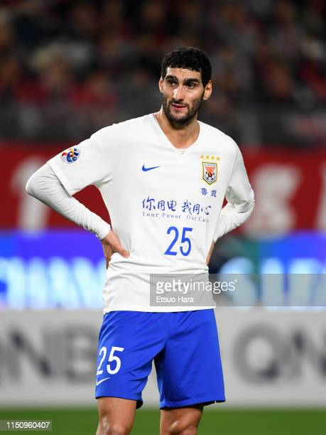 Marouane Fellaini of Shandong Luneng reacts during the AFC Champions League Group E match between Kashima Antlers and Shandong Luneng at Kashima...