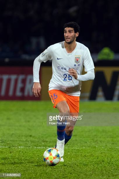 Marouane Fellaini of Shanong Luneng FC in action during the AFC Champions League Group E match between Johor Darul Ta'zim and Shandong Luneng at...