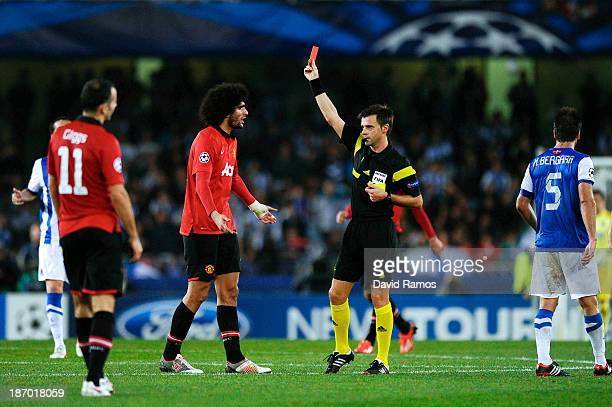 Marouanne Fellaini of Manchester United is shown a red card by referee Nicola Rizzoli for a challenge during the UEFA Champions League Group A match...