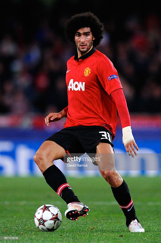 Marouanne Fellaini of Manchester United runs with the ball during the UEFA Champions League Group A match between Real Sociedad de Futbol and Manchester United at Estadio Anoeta on November 5, 2013 in San Sebastian, Spain.