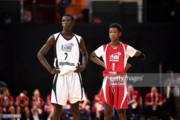 Marouf Moumine of Africa Middle East Boys and Jahliel Smart of Canada Boys look on during the game during the Jr NBA World Championship International...
