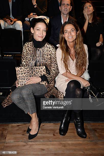 Marpessa Hennink and Cristina Lucchini attend the Dolce Gabbana show as a part of Milan Fashion Week Menswear Autumn/Winter 2014 on January 11 2014...