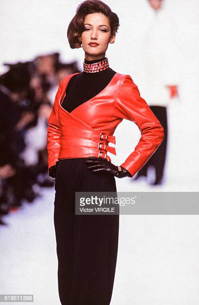 Marpessa Hennink walks the runway at the Claude Montana Ready to Wear Fall/Winter 19921993 fashion show during the Paris Fashion Week in March 1992...