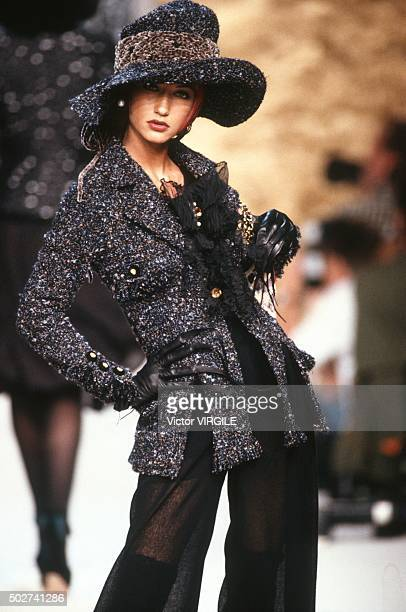 Marpessa Hennink walks the runway during the Chanel Haute Couture show as part of Paris Fashion Week Fall/Winter 19921993 in July 1992 in Paris France