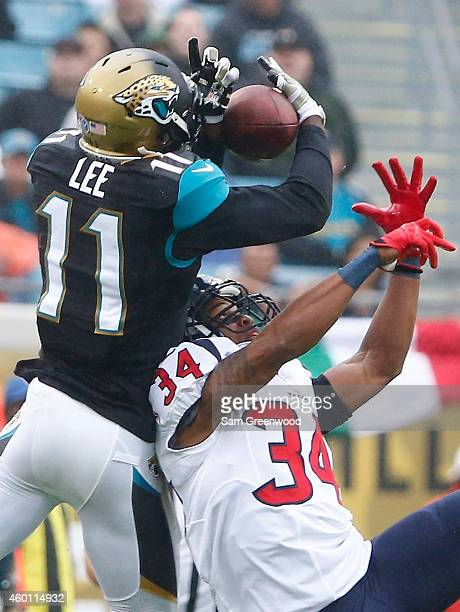 Marqise Lee of the Jacksonville Jaguars attempts a reception against AJ Bouye of the Houston Texans during the game at EverBank Field on December 7...