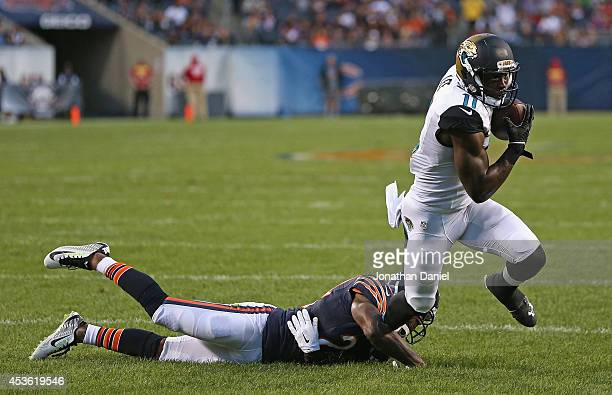 Marqise Lee of the Jacksonville Jaguars breaks away from Kelvin Hayden of the Chicago Bears for a touchdown during the first quarter of a preseason...