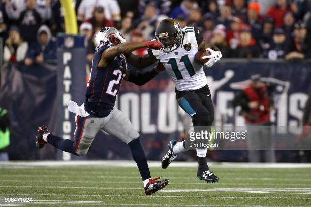 Marqise Lee of the Jacksonville Jaguars carries the ball after a catch as he is defended by Malcolm Butler of the New England Patriots in the second...