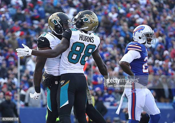Marqise Lee of the Jacksonville Jaguars celebrates his touchdown with Allen Hurns during NFL game action as Corey Graham of the Buffalo Bills looks...