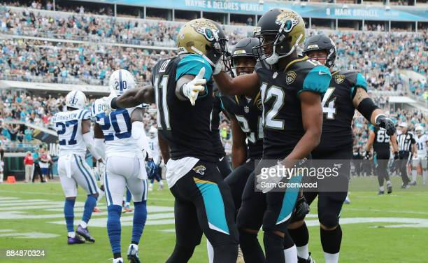Marqise Lee of the Jacksonville Jaguars celebrates with his teammates after a 4yard touchdown in the first half of their game against the...