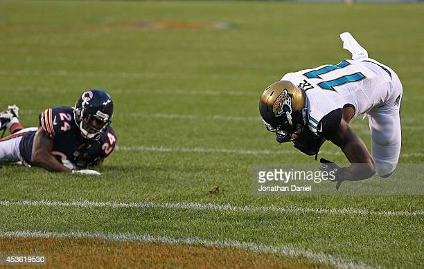 Marqise Lee of the Jacksonville Jaguars flips into the endzone after breaking away from Kelvin Hayden of the Chicago Bears for a touchdown during the...