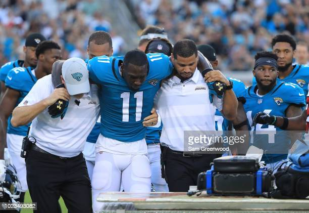 Marqise Lee of the Jacksonville Jaguars is helped off the field after an injury during a preseason game against the Atlanta Falconsat TIAA Bank Field...