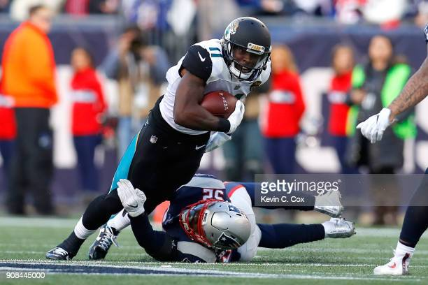 Marqise Lee of the Jacksonville Jaguars is tackled by Donald Payne of the Jacksonville Jaguars in the second quarter during the AFC Championship Game...