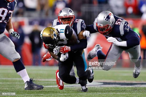 Marqise Lee of the Jacksonville Jaguars is tackled by Eric Rowe of the New England Patriots and Kyle Van Noy in the second half during the AFC...