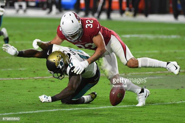 Marqise Lee of the Jacksonville Jaguars is tackled by Tyrann Mathieu of the Arizona Cardinals in the second half at University of Phoenix Stadium on...