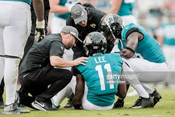 Marqise Lee of the Jacksonville Jaguars is tended to by the Jaguars training staff after suffering an injury during the second quarter of a game...