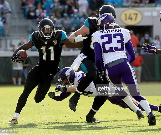 Marqise Lee of the Jacksonville Jaguars runs for yardage as Andrew Sendejo of the Minnesota Vikings attempts a tackle along the sidelineduring the...