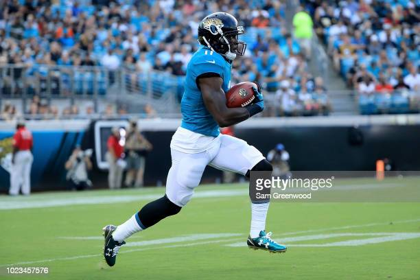 Marqise Lee of the Jacksonville Jaguars runs for yardage during a preseason game against the Atlanta Falcons at TIAA Bank Field on August 25, 2018 in...