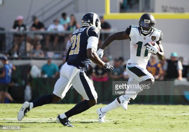Marqise Lee of the Jacksonville Jaguars runs with the football in front of Kayvon Webster of the Los Angeles Rams in the first half of their game at...