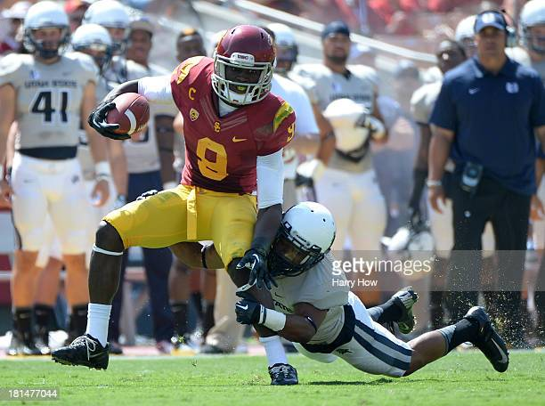 Marqise Lee of the USC Trojans is tackeld after his catch by Tay Glover-Wright of the Utah State Aggies during a 17-14 Trojan win at the Los Angeles...