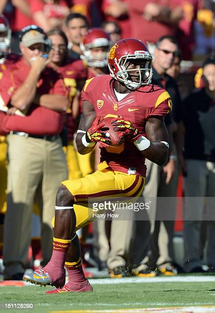 Marqise Lee of the USC Trojans makes a catch leading to a touchdown on the first play of the game against the Hawaii Warriors at Los Angeles Coliseum...