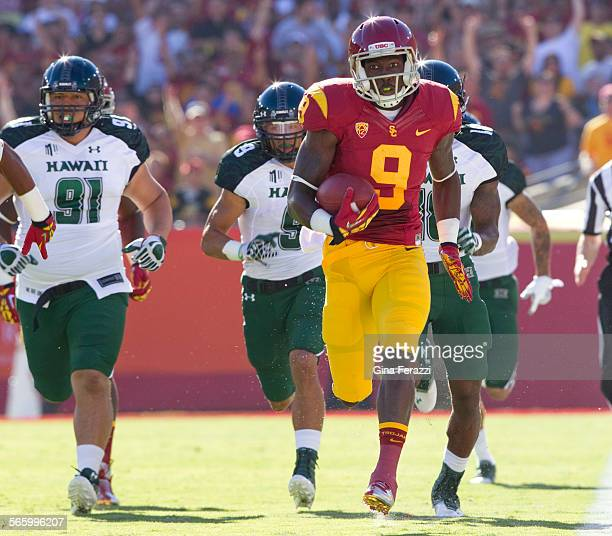 USC Marqise Lee races down the sideline after a pass from quarterback Matt Barkley for a 75–yard touchdown in the first quarter at the Los Angeles...