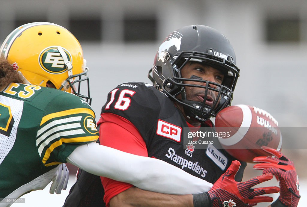 Marquay McDanie #16 of the Calgary Stampeders tries to hold on to the ball as Ryan Hinds #36 of the Edmonton Eskimos knock the ball away during the divisional finals at McMahon Stadium on November 23, 2014 in Calgary, Alberta, Canada.