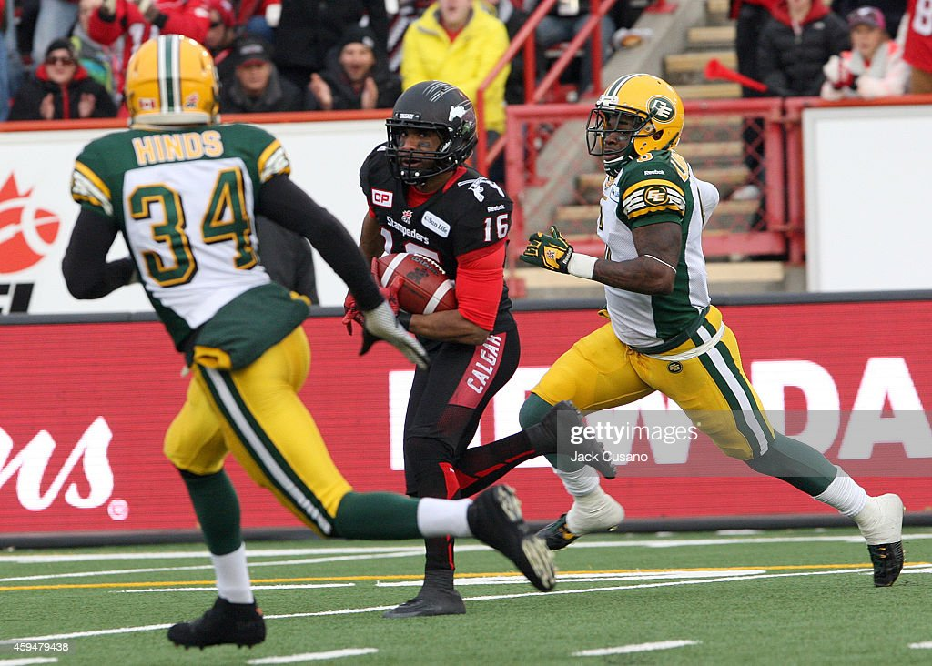 Marquay McDaniel #16 of the Calgary Stampeders runs by Kendial Lawrence #34 and Alzona Lawrence #6 of the Edmonton Eskimos for a touchdown during the divisional finals at McMahon Stadium on November 23, 2014 in Calgary, Alberta, Canada.