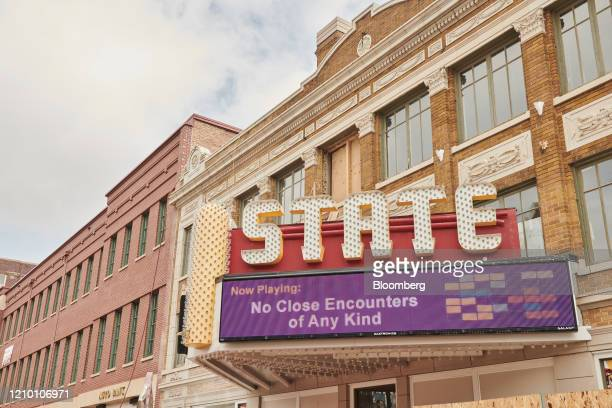 A marque displays a movie title parody outside the State Theater closed in Sioux Falls South Dakota US on Wednesday April 15 2020 South Dakota...