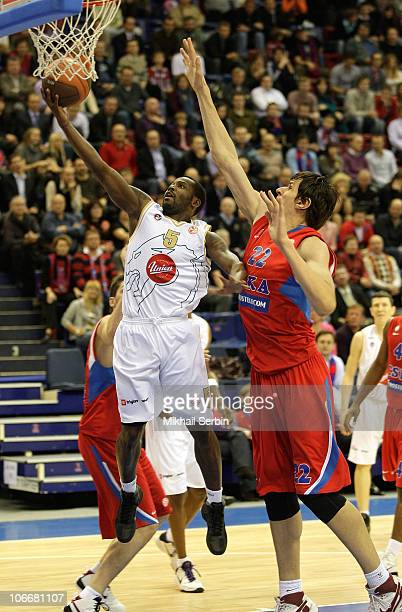Marque Perry, #5 of Union Olimpija competes with Boban Marjanovic, #22 of CSKA Moscow during the Turkish Airlines Euroleague Day 4 game between CSKA...