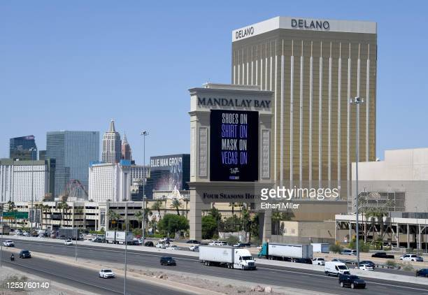 A marquee at Mandalay Bay Resort and Casino displays the message Shoes On Shirt On Mask On Vegas On after the Las Vegas Strip property opened for the...
