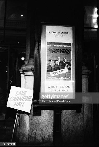 A marquee poster in front of Carnegie Hall announcing a sold out reunion concert of the folk vocal group The Weavers in April 1960 in New York City...